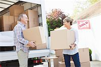 side view tractor trailer truck - Couple unloading boxes from moving van Stock Photo - Premium Royalty-Freenull, Code: 635-05652135