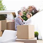 Couple standing near moving boxes Stock Photo - Premium Royalty-Freenull, Code: 635-05652143