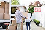 Couple unloading boxes from moving van Stock Photo - Premium Royalty-Free, Artist: Blend Images, Code: 635-05652170