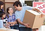 Family carrying moving boxes Stock Photo - Premium Royalty-Freenull, Code: 635-05652172