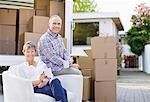 Couple sitting with moving and boxes Stock Photo - Premium Royalty-Free, Artist: Blend Images, Code: 635-05652177