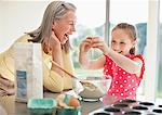Grandmother and granddaughter baking cupcakes Stock Photo - Premium Royalty-Freenull, Code: 635-05652179
