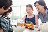 family table eating together - Family eating breakfast together Stock Photo - Premium Royalty-Freenull, Code: 635-05652181