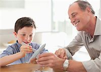 Grandfather and grandson assembling airplane model Stock Photo - Premium Royalty-Freenull, Code: 635-05652183
