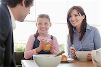 family table eating together - Family eating breakfast together Stock Photo - Premium Royalty-Freenull, Code: 635-05652241