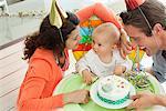 Parents celebrating baby's first birthday Stock Photo - Premium Royalty-Free, Code: 635-05652276