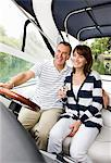 Couple riding in boat on river Stock Photo - Premium Royalty-Freenull, Code: 635-05652316