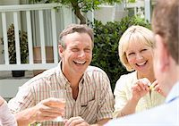 Friends eating and drinking outdoors together Stock Photo - Premium Royalty-Freenull, Code: 635-05652334