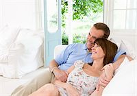 Couple reclining on sofa together Stock Photo - Premium Royalty-Freenull, Code: 635-05652357