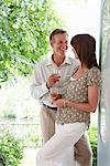 Couple drinking together outdoors Stock Photo - Premium Royalty-Free, Artist: Blend Images, Code: 635-05652369