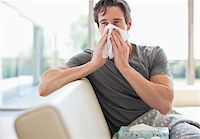 people coughing or sneezing - Sick man blowing his nose Stock Photo - Premium Royalty-Freenull, Code: 635-05652383