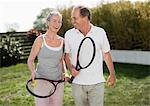 Couple outdoors holding tennis rackets Stock Photo - Premium Royalty-Freenull, Code: 635-05652389