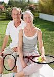 Smiling couple holding tennis rackets Stock Photo - Premium Royalty-Freenull, Code: 635-05652427