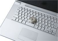 Computer keyboards with keyhole Stock Photo - Premium Royalty-Freenull, Code: 670-05652927