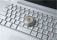 Computer keyboards with keyhole Stock Photo - Premium Royalty-Freenull, Code: 670-05652928