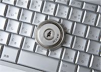 Computer keyboards with keyhole Stock Photo - Premium Royalty-Freenull, Code: 670-05652930