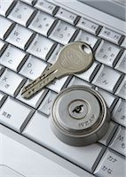Computer keyboards with keyhole and key Stock Photo - Premium Royalty-Freenull, Code: 670-05652931