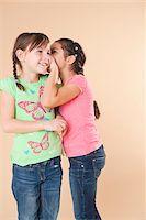 Portrait of Girls Whispering Stock Photo - Premium Royalty-Freenull, Code: 600-05653072