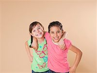 Portrait of Girls Hugging Stock Photo - Premium Royalty-Freenull, Code: 600-05653073