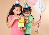 Portrait of Girls Looking at Gift Stock Photo - Premium Royalty-Freenull, Code: 600-05653079