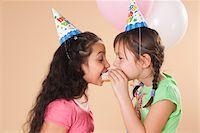 Portrait of Girls Eating Doughnut Stock Photo - Premium Royalty-Freenull, Code: 600-05653080