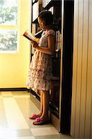 preteen asian girls - Girl Reading in Library Stock Photo - Premium Rights-Managednull, Code: 700-05653169