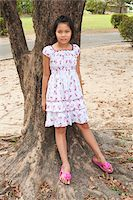 preteen thong - Girl Leaning Against Tree, Bangkok, Thailand Stock Photo - Premium Rights-Managednull, Code: 700-05653174