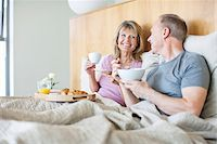 Happy senior couple enjoying breakfast in bed Stock Photo - Premium Royalty-Freenull, Code: 635-05655778