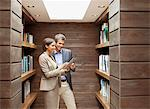 Businessman and businesswoman using digital tablet in office library Stock Photo - Premium Royalty-Freenull, Code: 635-05655929