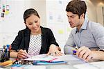 Businessman and businesswoman reviewing paperwork in office Stock Photo - Premium Royalty-Freenull, Code: 635-05655935