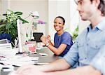 Portrait of smiling businesswoman at desk in office Stock Photo - Premium Royalty-Free, Artist: Blend Images, Code: 635-05655961