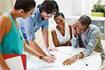 Business people reviewing paperwork in meeting Stock Photo - Premium Royalty-Freenull, Code: 635-05655998