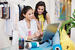 Fashion designers using laptop in office Stock Photo - Premium Royalty-Freenull, Code: 635-05656000