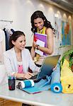 Fashion designers using laptop in office Stock Photo - Premium Royalty-Freenull, Code: 635-05656029