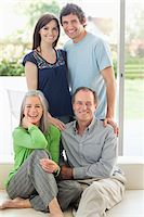 Portrait of smiling parents and adult children Stock Photo - Premium Royalty-Freenull, Code: 635-05656090