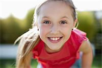 portrait smile caucasian one - Close up portrait of girl with toothy smile Stock Photo - Premium Royalty-Freenull, Code: 635-05656093