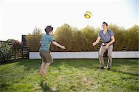 Father and son playing soccer in backyard Stock Photo - Premium Royalty-Freenull, Code: 635-05656122