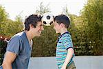 Soccer ball between father and son Stock Photo - Premium Royalty-Freenull, Code: 635-05656145