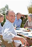 Portrait of smiling man enjoying lunch at patio table with friends Stock Photo - Premium Royalty-Freenull, Code: 635-05656183