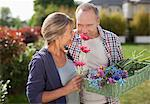 Senior couple smelling flowers in garden Stock Photo - Premium Royalty-Freenull, Code: 635-05656218