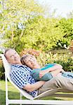 Portrait of smiling senior couple laying in lounge chair in backyard Stock Photo - Premium Royalty-Freenull, Code: 635-05656226