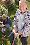 Portrait of smiling senior man working in sunny garden Stock Photo - Premium Royalty-Freenull, Code: 635-05656234