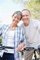 Portrait of smiling senior couple with bicycles Stock Photo - Premium Royalty-Freenull, Code: 635-05656237