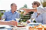 Man pouring wine at sunny table Stock Photo - Premium Royalty-Freenull, Code: 635-05656241