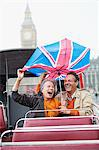 Rain falling on couple with British Flag umbrella on double decker bus Stock Photo - Premium Royalty-Free, Artist: foodanddrinkphotos, Code: 635-05656306