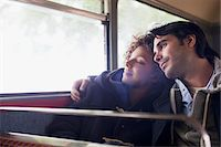 Serene couple hugging on bus Stock Photo - Premium Royalty-Freenull, Code: 635-05656312