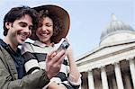 Couple with digital camera near historical landmark Stock Photo - Premium Royalty-Freenull, Code: 635-05656314