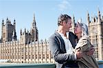 Happy couple hugging in front of Parliament Buildings in London Stock Photo - Premium Royalty-Freenull, Code: 635-05656321