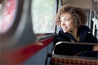 Smiling woman riding bus Stock Photo - Premium Royalty-Freenull, Code: 635-05656332