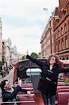 Exuberant couple riding double decker bus in London Stock Photo - Premium Royalty-Free, Artist: Blend Images, Code: 635-05656334